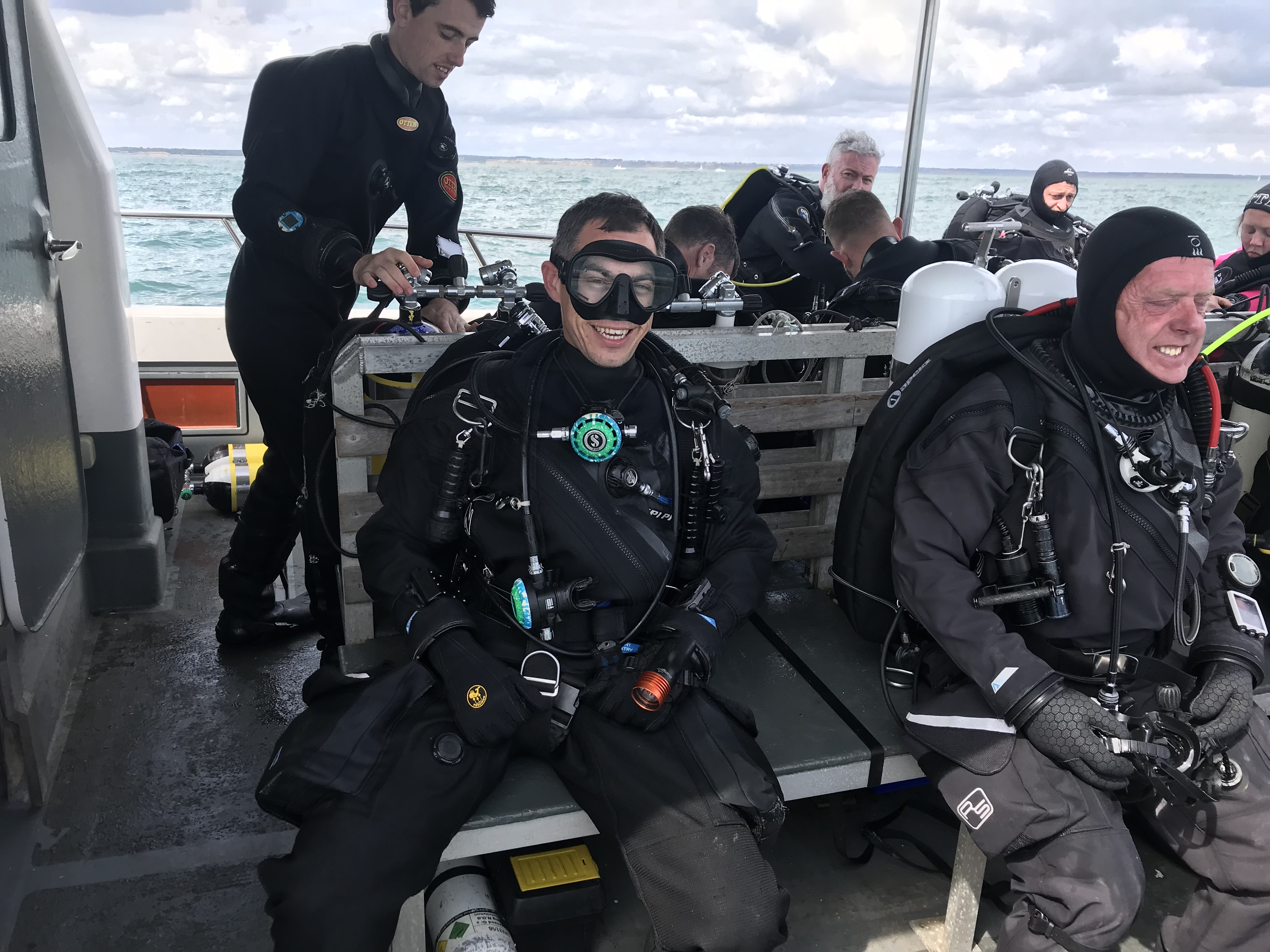 Diver on bench, fully kitted with Finnsub Bang torch